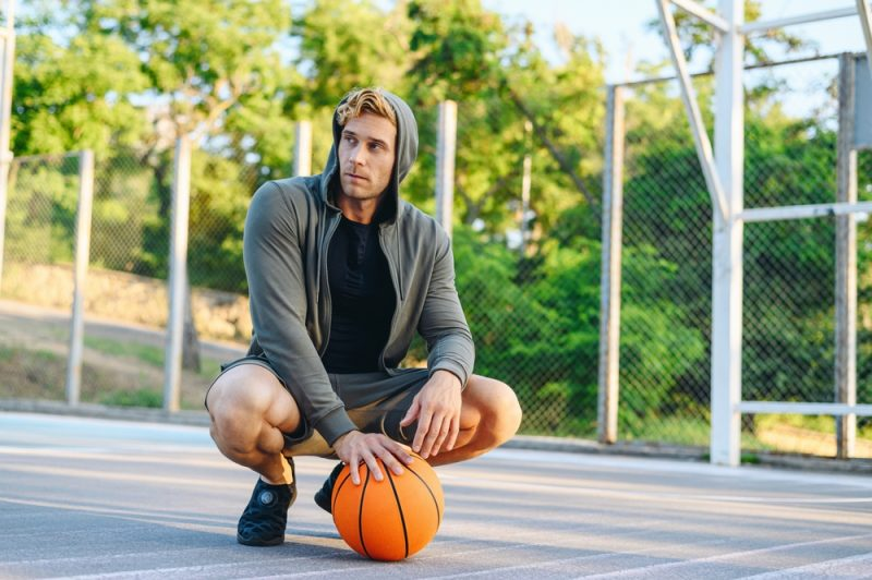 Man on Basketball Court with Sneakers