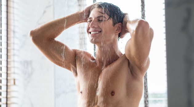 Man with Hairless Chest Taking a Shower