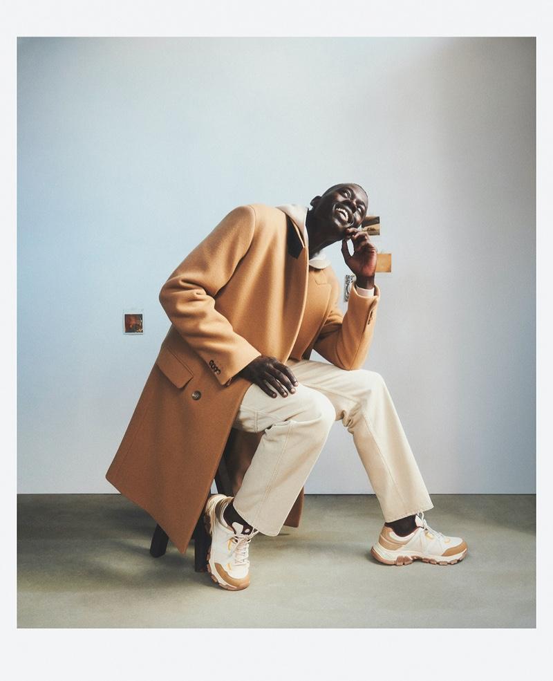 Top model Alpha Dia sports a long coat for Mango's fall 2021 campaign.