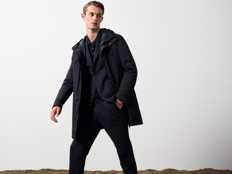 British model Kit Butler wears a parka over a suit from Massimo Dutti's fall 2021 Join Life collection.