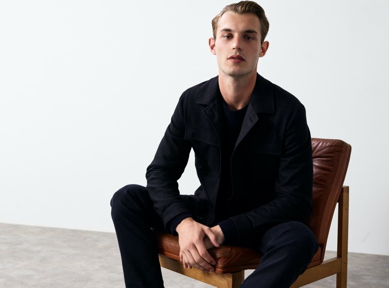 Modeling a Massimo Dutti look from its Join Life collection, Kit Butler showcases an overshirt with a wool-cashmere sweater and slim-fit jeans.