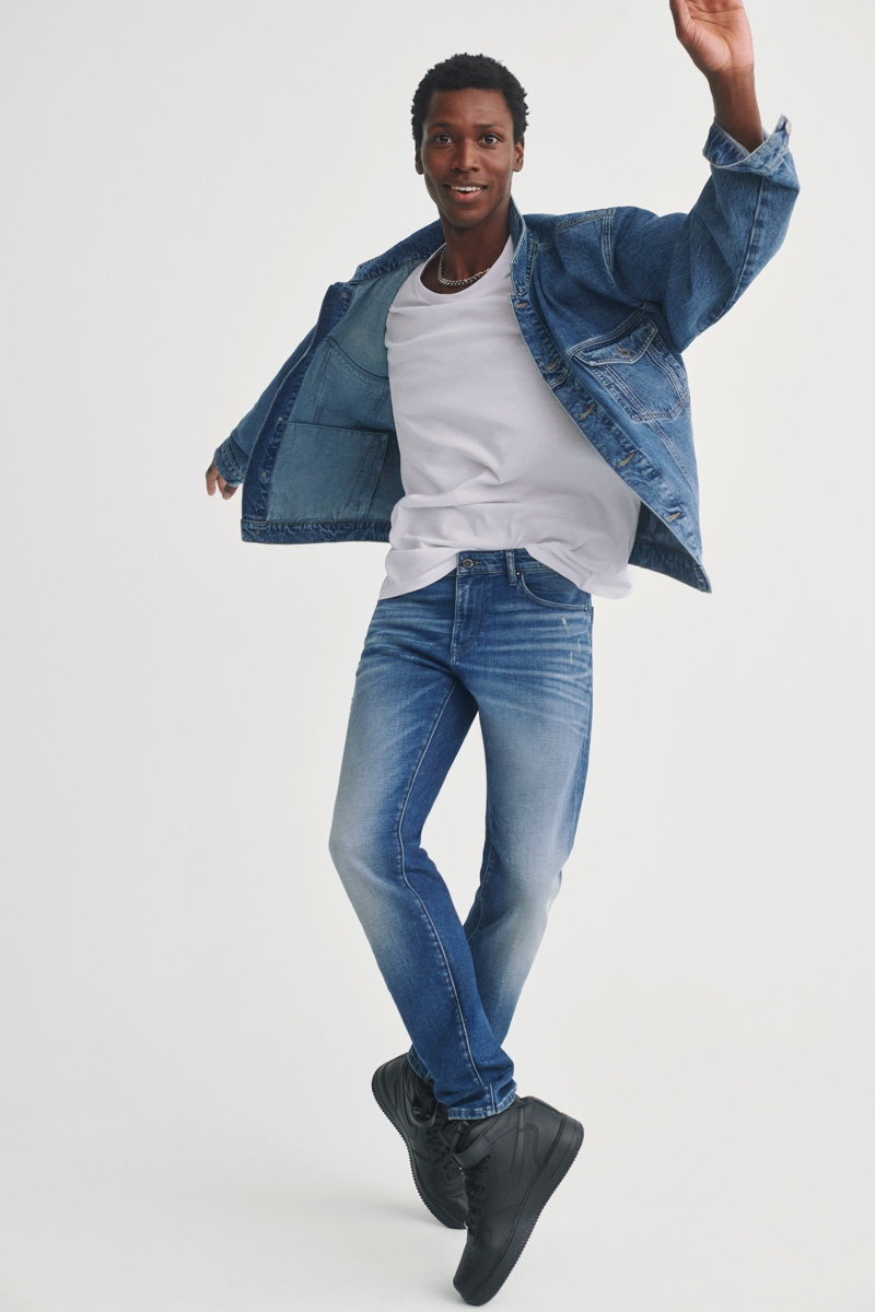Calvin Royal III doubles down on distressed denim in a jacket and jeans from Mavi's fall-winter 2021 collection.