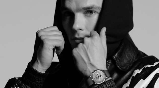 Nicholas Hoult dons Jaeger LeCoultre's Master Control Chronograph Calendar watch.