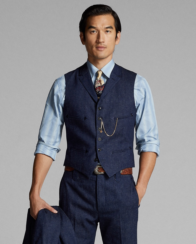 Tony Chung wears a notch-lapel denim vest with matching pants from Ralph Lauren Double RL.