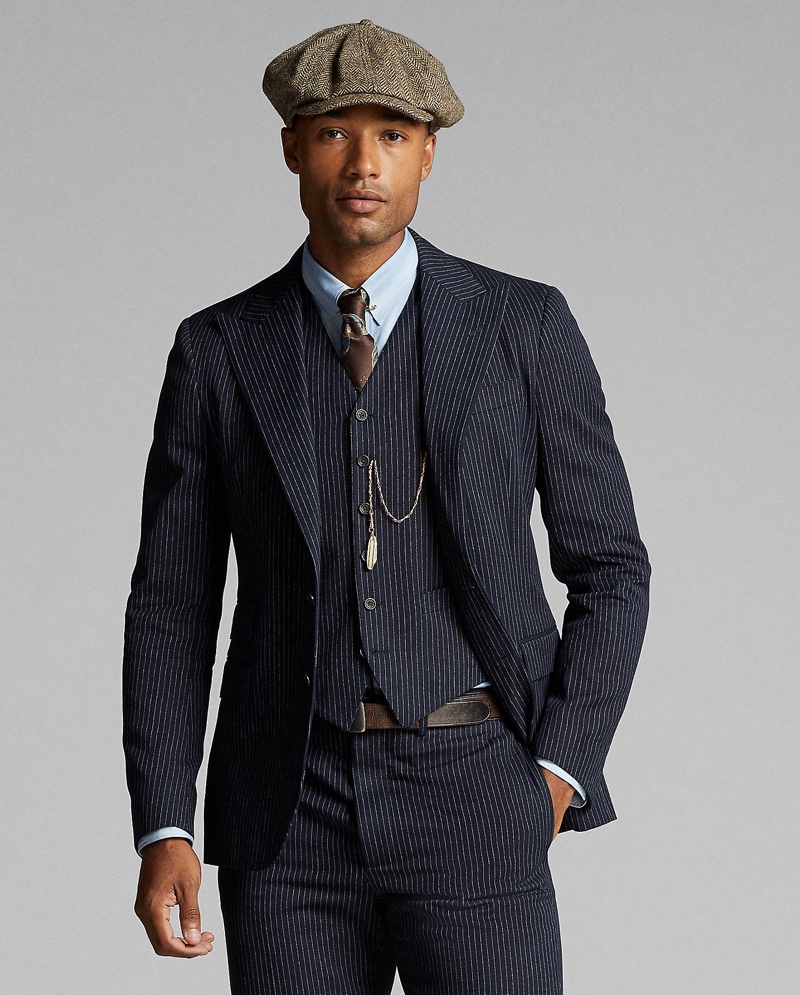 In front and center, Michael Ayeboua dons Ralph Lauren Double RL's indigo striped herringbone vest with matching trousers.