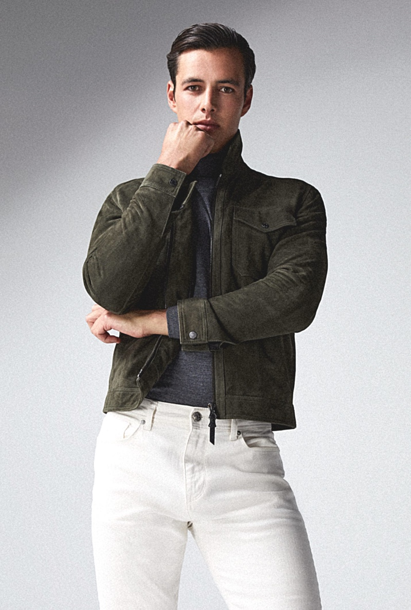 In front and center, Harry Gozzett models a pair of white jeans with Reiss' Pike suede jacket and Caine turtleneck.