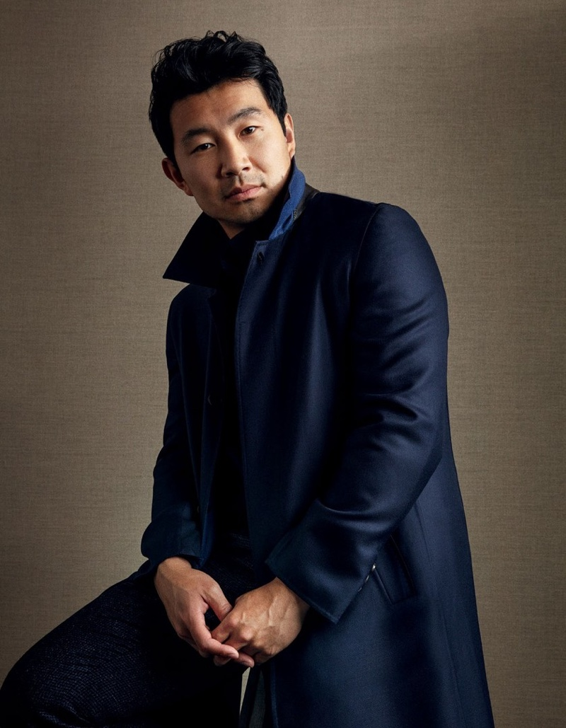 Actor Simu Liu dons a Brioni coat with a cardigan and trousers by Brunello Cucinelli for Esquire Singapore.