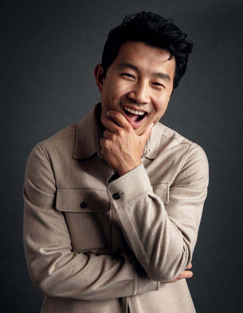 All smiles, Simu Liu wears a Brioni overshirt for Esquire Singapore.