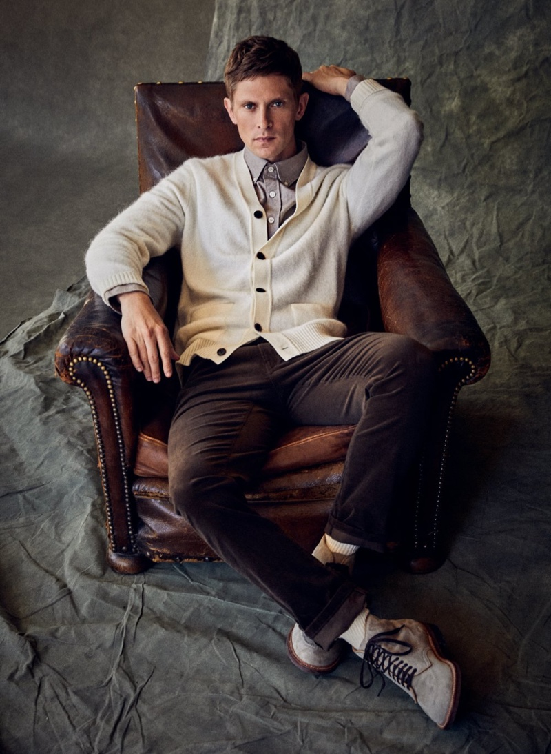 Dressed smartly head to toe, Mathias Lauridsen charms in a cashmere cardigan by Todd Snyder.