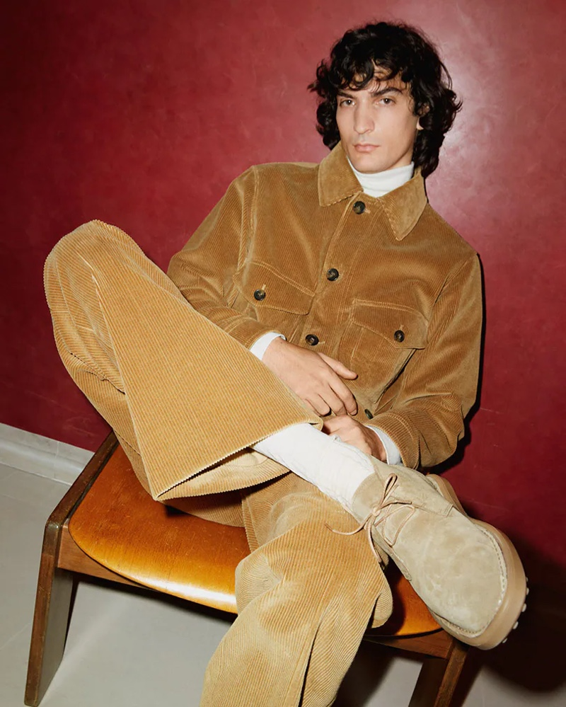 Luca Lemaire dons a corduroy look and wears desert boots for Tod's fall-winter 2021 men's campaign.