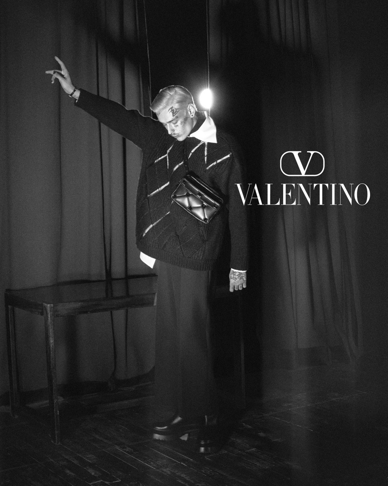 Model Teddy Corsica appears in a black and white image for Valentino's fall-winter 2021 men's campaign.