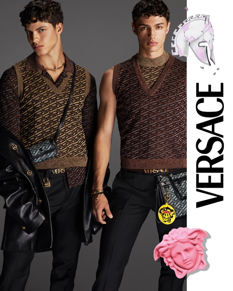 Embracing amsrt style in chic sweater vests, Nacho Penín and Ondrej Mokoš front Versace's fall 2021 men's campaign.