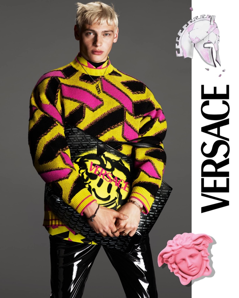 Lucas Barski rocks a graphic sweater for Versace's fall 2021 men's campaign.