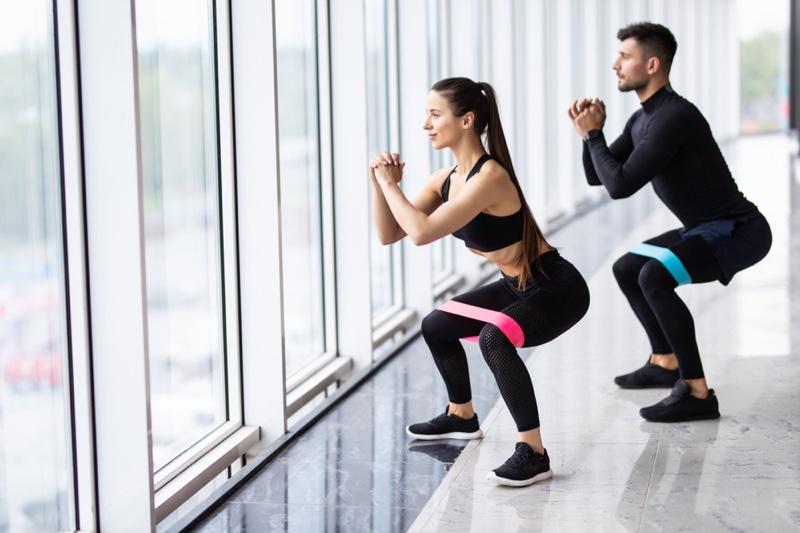 Woman Man Squatting Workout Black Outfits
