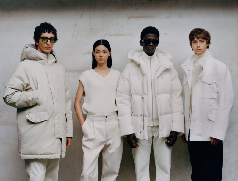 Sporting white and off-white clothing, Takfarines Bengana, Mika Schneider, Moustapha Sy, and Chester Mckee model Zara's Origins collection.