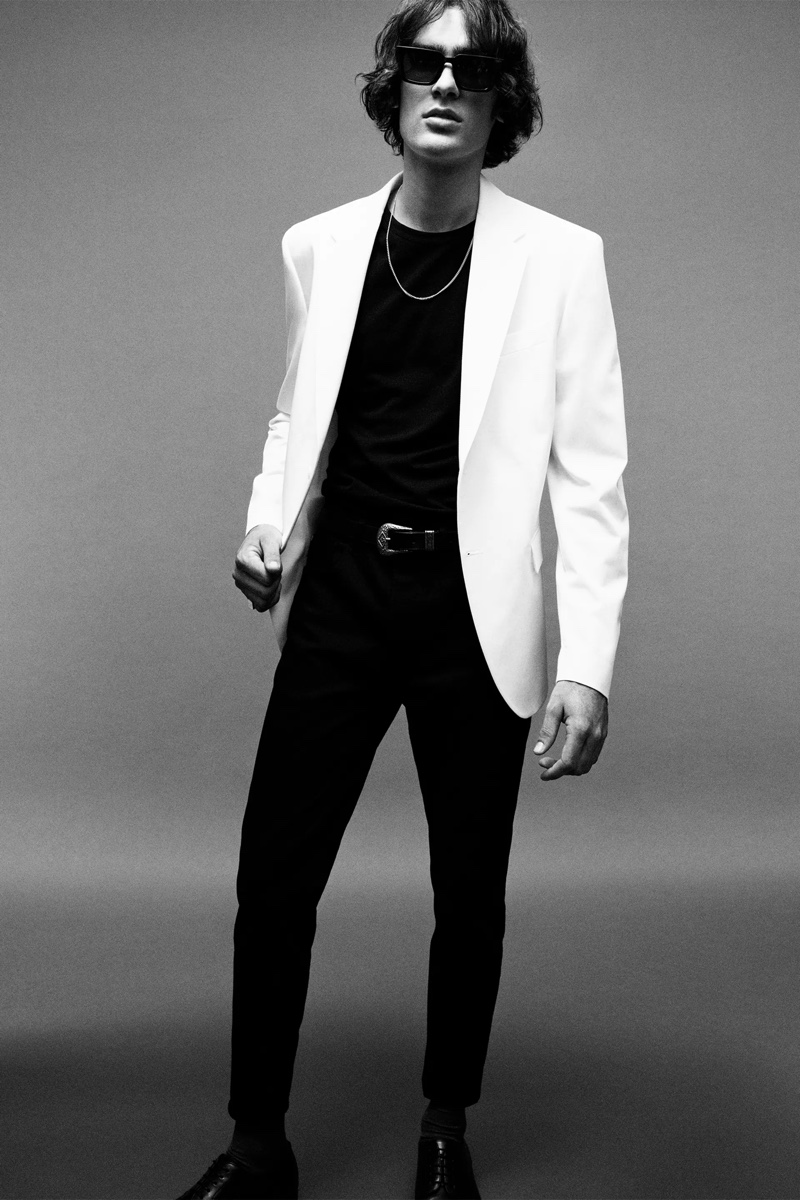 In front and center, Marijn Aper sports a slim-fit blazer with a t-shirt and pants from Zara Man's Rock collection.