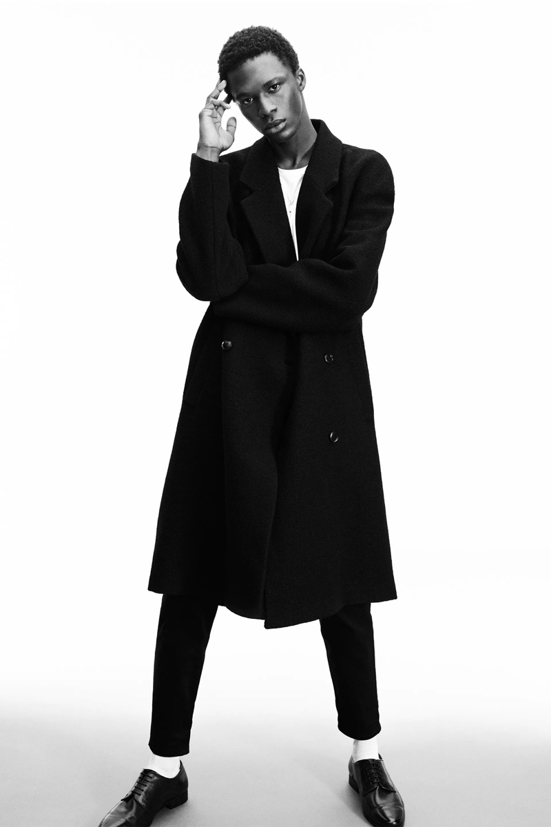 Making a sleek statement in black, Cherif wears Zara Man's cloth coat from its Rock collection.