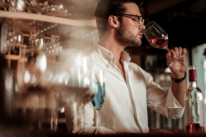 Attractive Man Smelling Wine