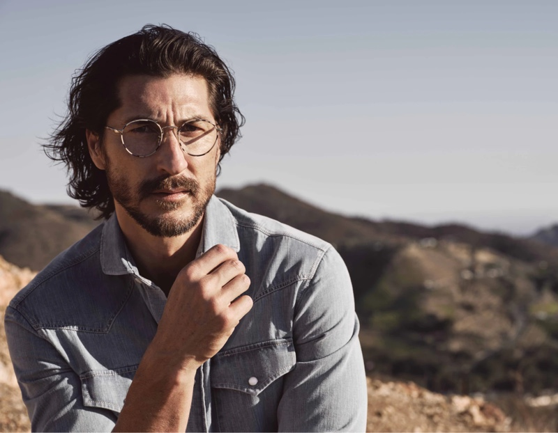 Ryan Porter dons glasses for the fall-winter 2021 Brunello Cucinelli x Oliver Peoples eyewear campaign.