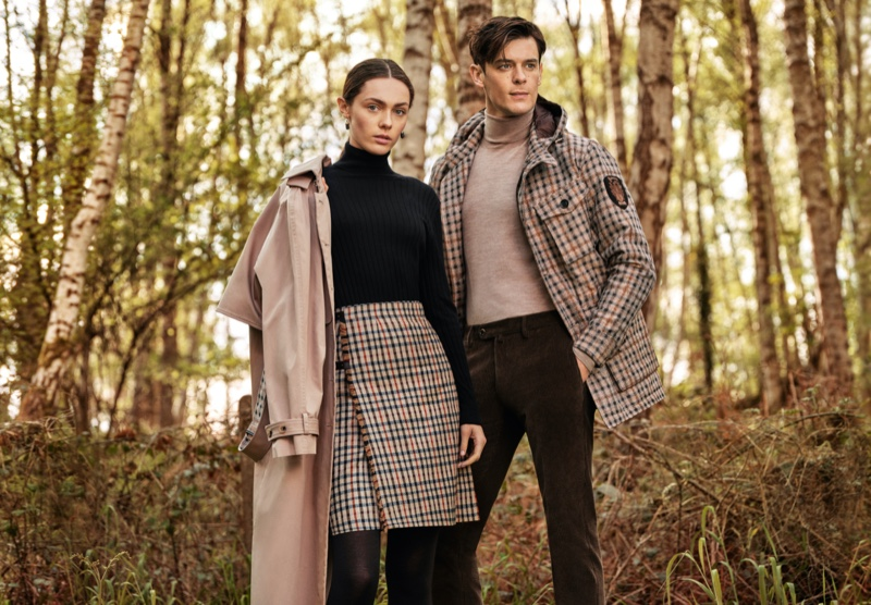 Wearing his 'n' her looks, models Lewis Jamison and Sophia Roberts appear in Daks' fall-winter 2021 campaign.