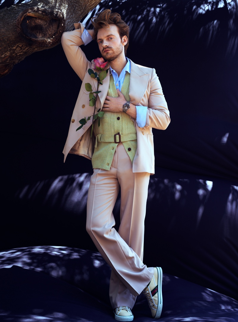 Connecting with VMAN, Finneas dons a Gucci look with an Omega 007 Edition watch.