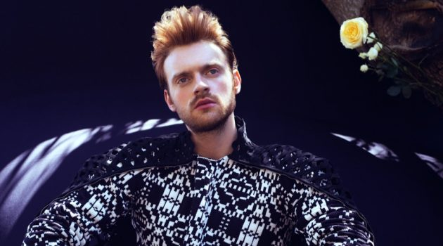 Embracing a graphic black and white look, Finneas wears Comme des Garçons with a Valentino cape for VMAN.