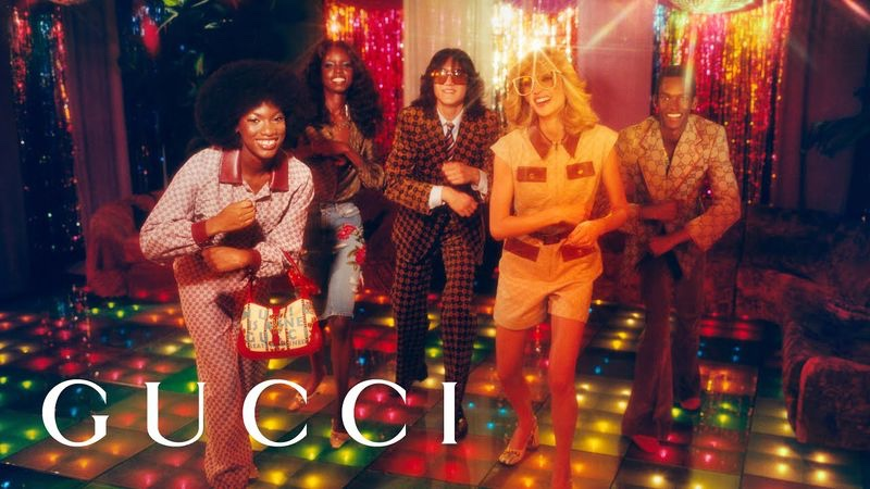 Grace Epolo, Lamich Kirabo, Branko Roegiest, Claire DeLozier, and Don Nahumuremy channel seventies style with a disco-themed image from the Gucci 100 campaign.