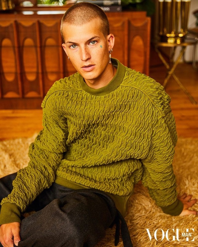 In front and center, Gus Dapperton sports a sweater and pants from Ermenegildo Zegna for Vogue Man Hong Kong.