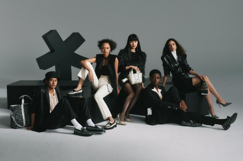 Models Yudai Tateishi, Aria Polkey, Kiko Arai, Destiny Imade, and Liz Panova model footwear from the Jimmy Choo x Eric Haze collection.