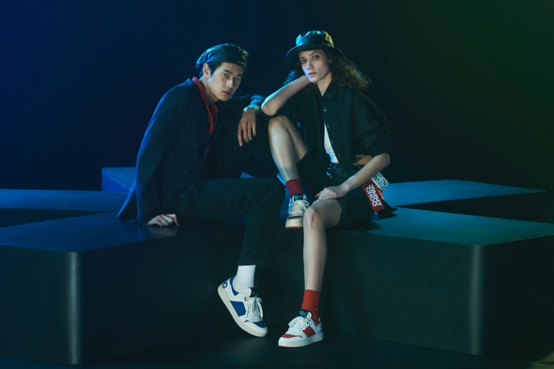 Models Yudai Tateishi and Liz Panova sport sneakers from the Jimmy Choo x Eric Haze collection.