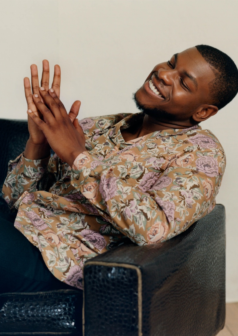 All smiles, John Boyega wears a floral print shirt from his H&M capsule collection.