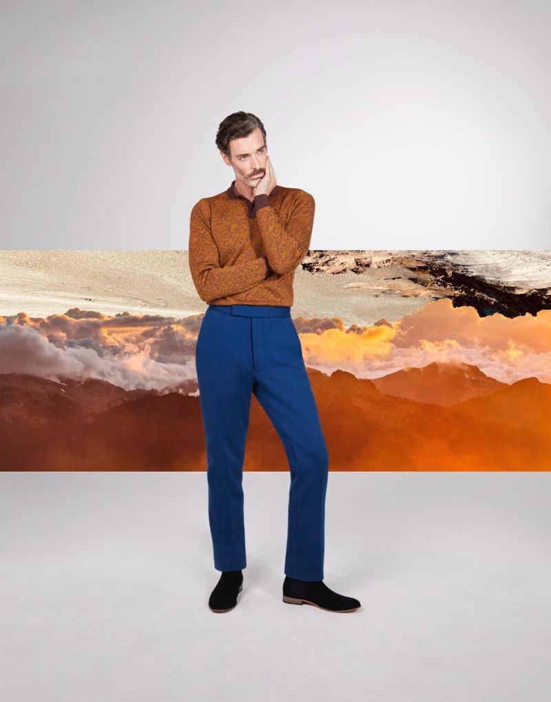 Richard Biedul dons a long-sleeve knit polo from John Smedley's fall-winter 2021 collection.