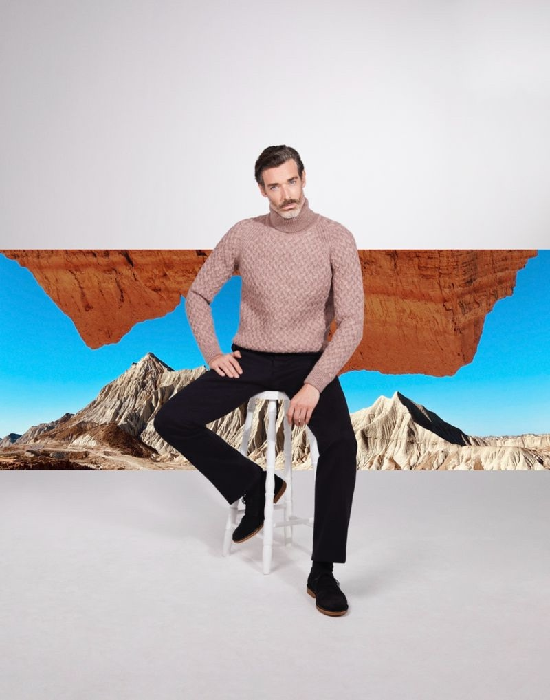 Sitting for a photo, Richard Biedul wears a cable-knit turtleneck from John Smedley.