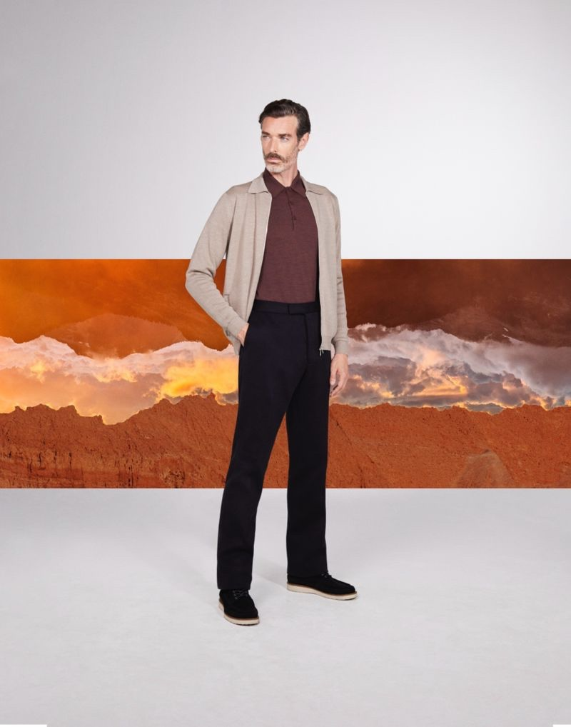 A smart vision, Richard Biedul dons knitwear from John Smedley's fall-winter 2021 collection.