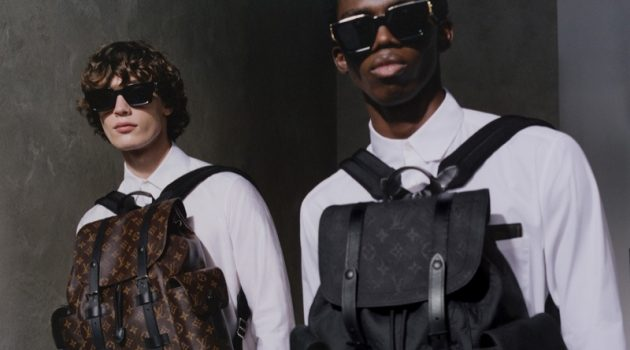 Models Freek Iven and Ottawa Kwami wear Louis Vuitton's Christopher PM backpacks.