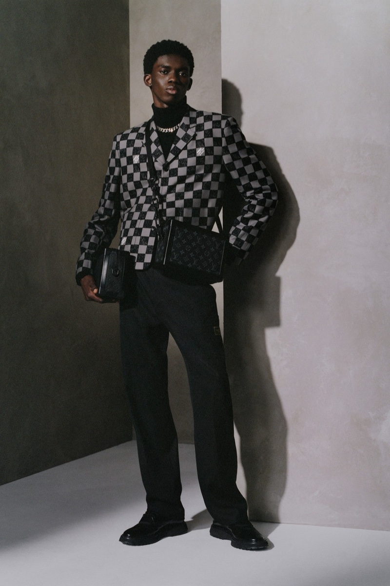 In front and center, Ottawa Kwami poses with Louis Vuitton's Soft Trunk bags.
