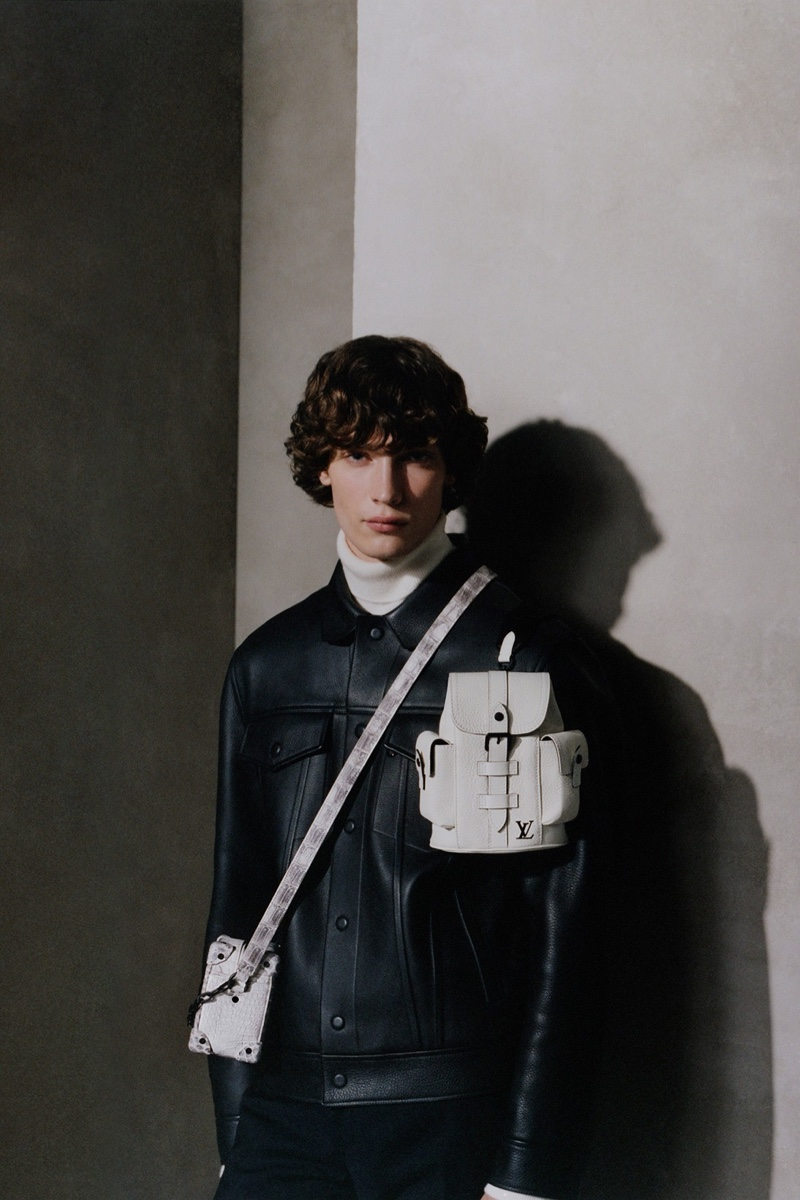 Freek Iven makes a style statement with Louis Vuitton's Christopher XS and Soft Trunk bags in white.