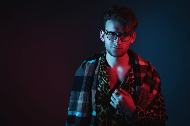 Man Wearing Leopard Shirt and Glasses