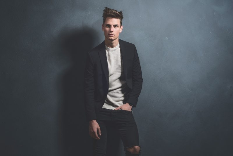 Man in Black Jeans Blazer and Sweater
