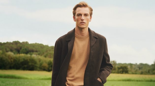 Quentin Demeester dons a single-breasted coat with a crewneck sweater and corduroy pants by Mango.