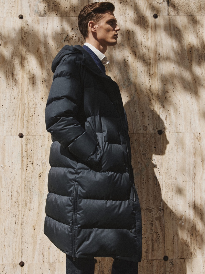 Xavier Gibson dons a a hooded puffer from Massimo Dutti's fall-winter 2021 collection.