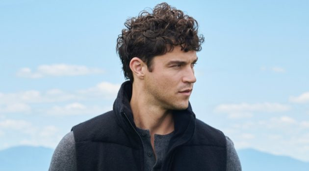 Miles McMillan stays warm in a puffer vest and henley for NAKEDCASHMERE's fall 2021 campaign.