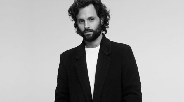 Penn Badgley dons a Mr P. cashmere coat, Tom Ford shirt t-shirt, and Saint Laurent chinos for Mr Porter.
