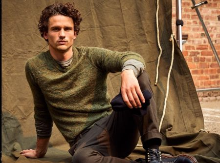 Taking a seat, Simon Nessman dons Todd Snyder's brushed Italian mohair sweater with Italian moleskin carpenter pants.