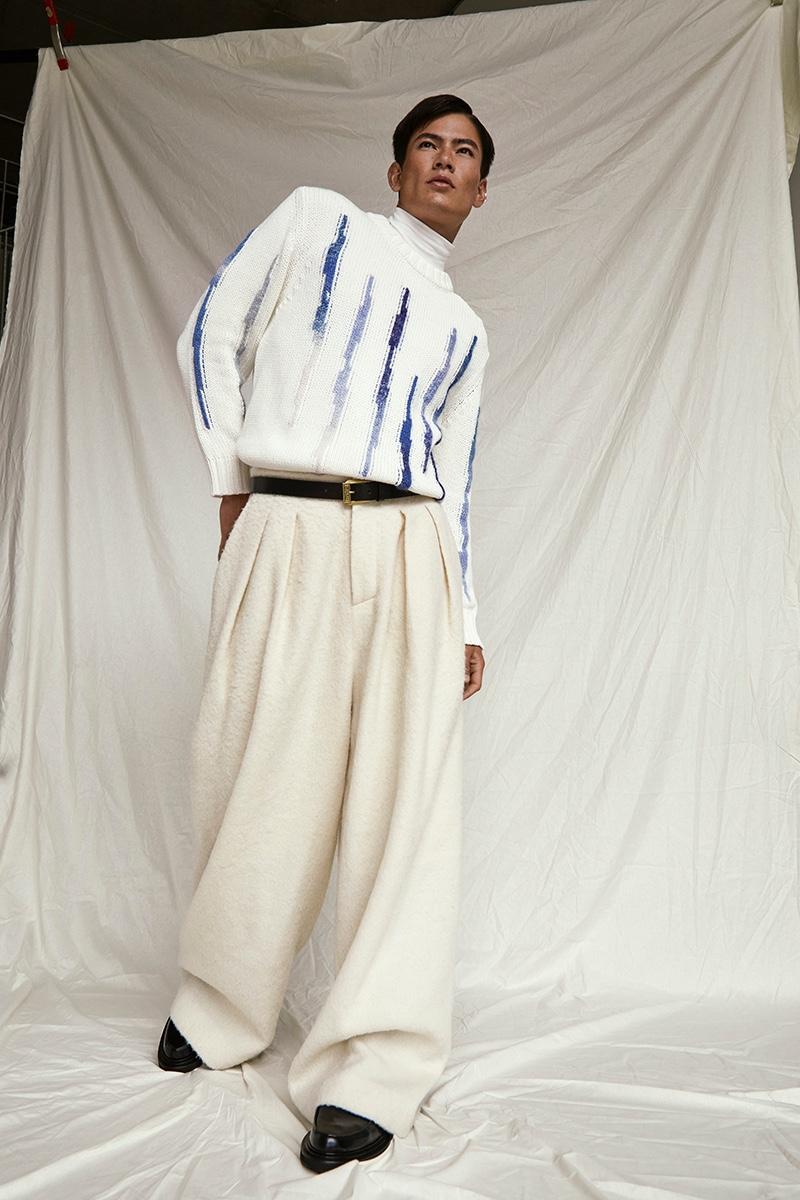 Simonas wears turtleneck Alpha Tauri, pullover NN07, belt Versace, pants Franziska Michael, and shoes The Kooples.