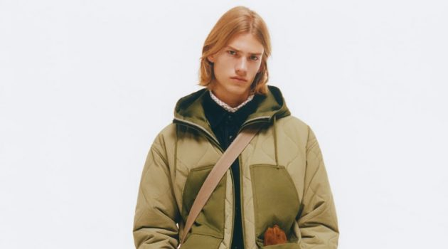 Model Martijn Faaij wears a combination puffer jacket with textured cotton pants by Zara.